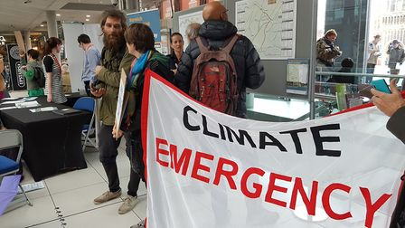 Norwich Extinction Rebellion take over Western Link road consultation event at the Forum