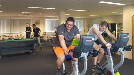 Employees at iGO4 take part in a cycle challenge to raise money for Cancer Research Picture: iGO4
