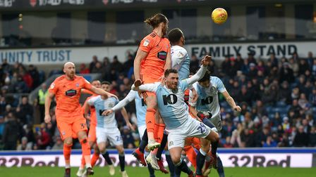 Will Keane iwith a glancing header across the face of goal at Ewood Park Picture Pagepix