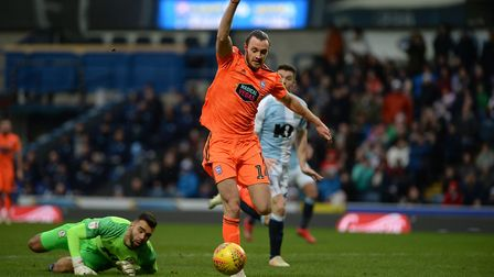 Will Keane beats the keeper but then denied after being forced wide at Ewood Park during the first h
