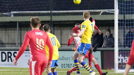 Billy Holland heads home the winning goal for Sudbury in a dramatic finish Photo: PAUL VOLLER