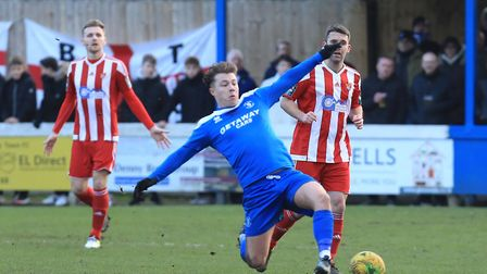 Bury Town man-of-the-match, Jake Chambers Shaw, stretches the Felixstowe defence Photo: STAN BASTON