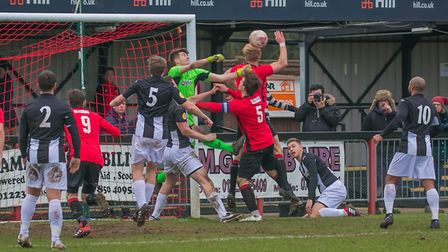 Woodbridge 'keeper Alfie Stronge punches clear at Histon Photo: PAUL LEECH