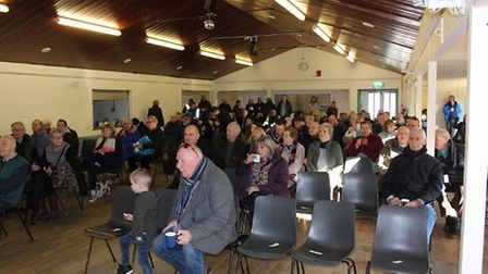 People from Long Melford gather at the village hall after taking part in the Save Our Skylark Field