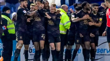 Mansfield Town's players celebrate with CJ Hamilton (22) after his late winner in Saturday's 3-2 suc
