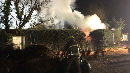 Firefighters are putting out flames at a 400-year-old cottage in Ardleigh, Essex Picture: JAKE FOXFO