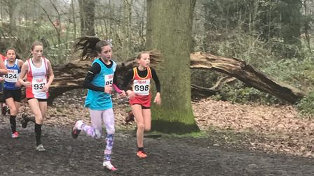 Tia Clancy (blue vest), who marked her West Suffolk AC debut with 221st spot in the under-13 girls'
