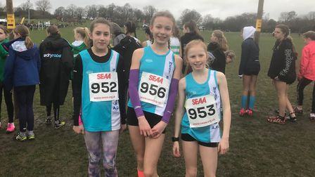 The West Suffolk AC trio of Tia Clancy, Amelie Taylor and Phoebe Harpur-Davies, at the South of Engl