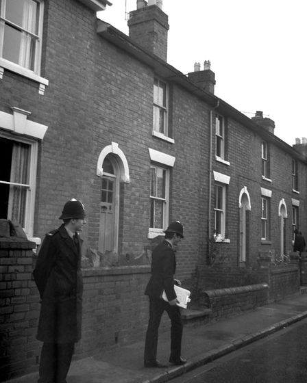 Policemen outside the house in Worcester, where the bodies of the three young children were found im
