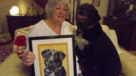 Bowza with local artist Liz, who painted his portrait free of charge Picture: DON COX