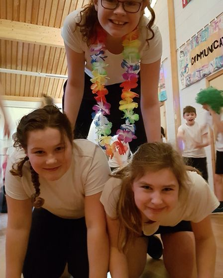 Pupils took on the mammoth fundraising challenge to help raise �15,000 for much-needed new interacti