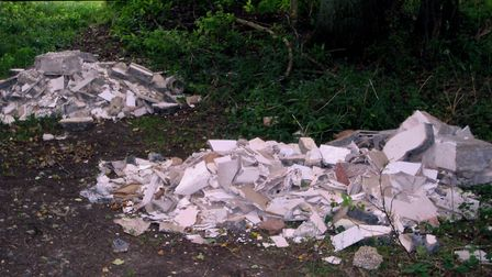 Fly-tipping near wooded glade in Lawshall.