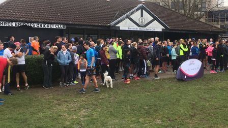 Runners and joggers assemble in front of Harrow St Mary's Pavilion befoe the start of last Saturday'