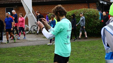 Your columnist, Carl Marston, seen here fiddling with the camera on his iPhone before the start of l