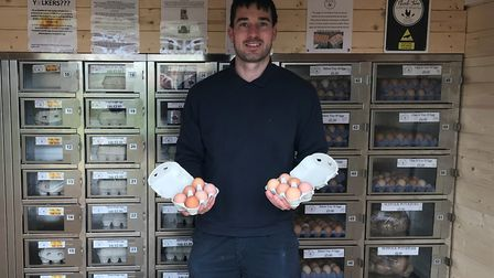 Chris Hull of Church Farm, Occold, with his egg vending machine Picture: DAN HULL