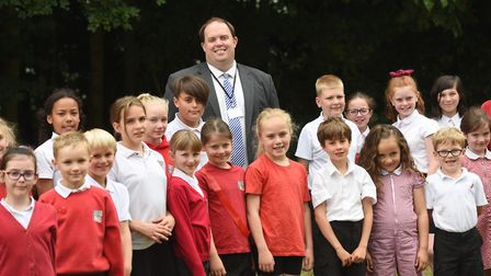 Headteacher Daniel Woodrow with pupils from St Gregory CEVC Primary School in Sudbury. Picture: GREG