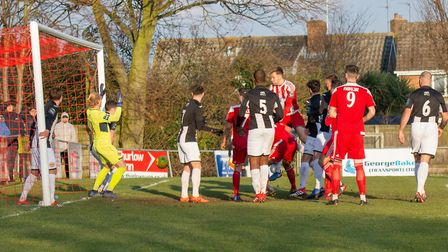 GOAL: Seasiders Josh Kerridge (centre, red and white) leaps higher than everyone else to head the ho