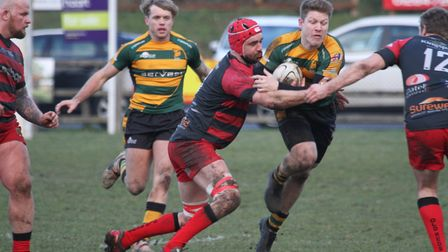 Mark Kohler charges through the Old Reds defence on Saturday Photo: SHAWN PEARCE PHOTOGRAPHY