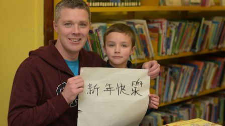 Cillian and Thomas Geraghty at the Chinese New Year workshop at Newmarket library Picture: SARAH LU