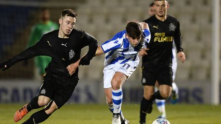 Colchester United's new loan signing, Callum Roberts, in action for Newcastle United Under-23s, tryi