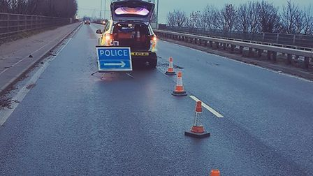 The pothole is near the centre of the road in the right-hand lane, posing a threat to anyone travell