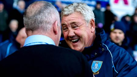 Sheffield Wednesday manager Steve Bruce greets Town manager Paul Lambert ahead of the game. Pictu