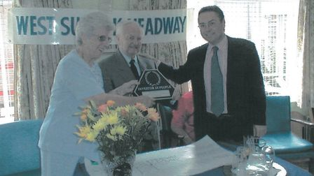 Stella and Bill accept an honour on behalf of West Suffolk Headway from then Bury St Edmunds MP Davi