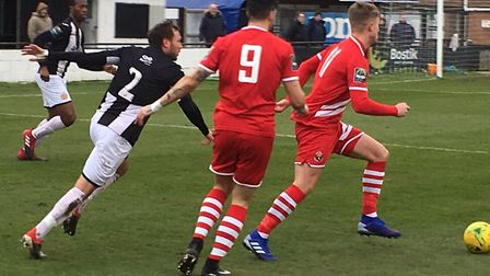 Heybridge full-back Reece Morgan chases AFC Sudbury's Freddie King, with Phill Kelly (No. 9) in clo