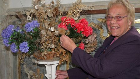 Beryl Ruse placing flowers at St Mary's church.