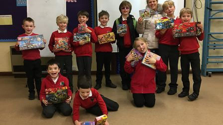 Children from All Saints Church of England Primary School and organiser Sarah Hill, pictured with th