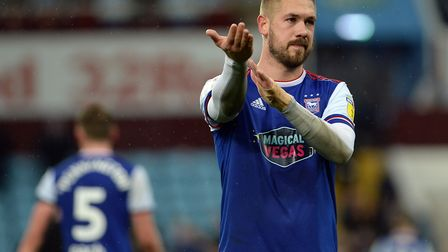 Ipswich captain Luke Chambers commiserates with the travelling supporters at Villa Park - gesturing
