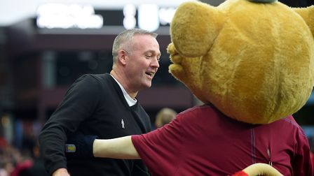 Paul Lambert after he has been given a cuddle by one of the Aston Villa mascots Picture Pagepix