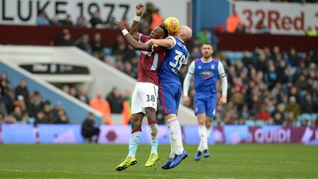 James Collins tries to stick close to Tammy Abrahams at Villa Park Picture Pagepix