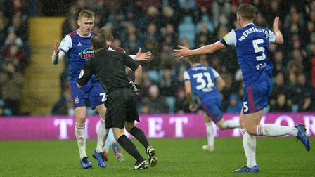 Flynn Downes and Matthew Pennington both appeal for the handball at Villa Park Picture Pagepix
