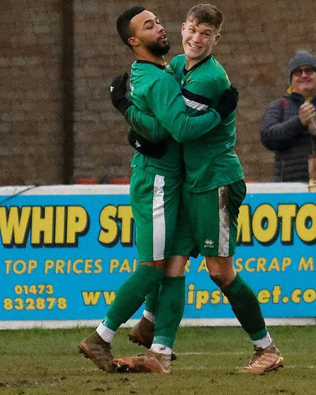 Isaac Galliford celebrates with Harry Draper after scoring Hitchin's second goal at Leiston. Picture