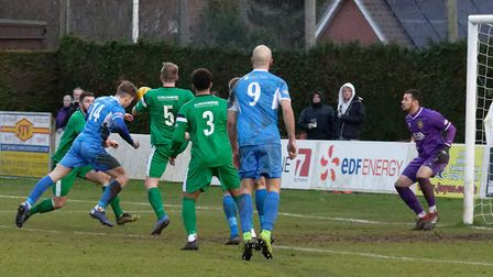William Davies gets his head to a cross to score for Leiston. Picture: PAUL VOLLER