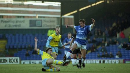 Paul Mason jumps over a challenge during Town's 5-0 win over West Brom at Portman Road in January 19