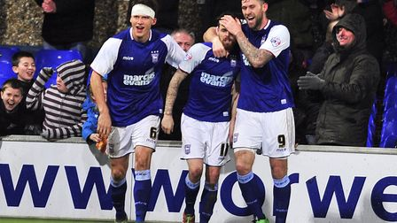 Paul Anderson celebrates scoring Town's second goal with Daryl Murphy and Christophe Berra