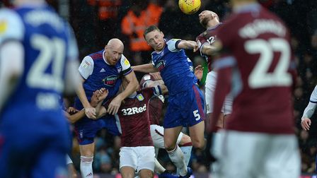 Matthew Pennington and James Collins battle in a congested penalty area at Villa Park Picture Pagepi
