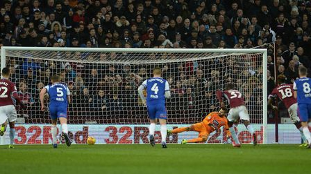 Ipswich keeper Bartosz Bialkowski is sent the wrong way by Tammy Abraham from the penalty spot as Vi