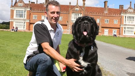 Suffolk Dog Day is one of the top dog-friendly events in Suffolk. Pictured, Teddy with Brian Wade .