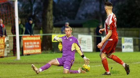 Miles Powell scores the winning goal for Felixstowe & Walton against Great Wakering. Picture: STAN B
