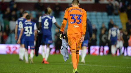 Ipswich keeper Bartosz Bialkowski makes his way off the pitch at Aston Villa Picture Pagepix