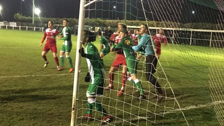 Goalmouth action during last Tuesday week's Thurlow Nunn Premier clash, between Whitton United and G