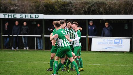 Flashback: Whitton United celebrate a goal against Coggeshall, two years ago, with supporters watchi