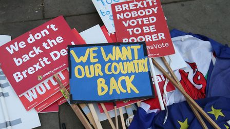 Brexit protestors' placards lay on the ground near Parliament in London, in January. Picture: Jonath
