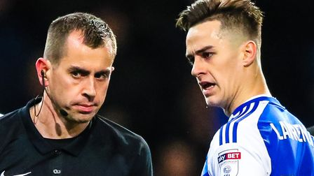 Former Town loanee Tom Lawrence has words with referee Peter Bankes back in 2016. Bankes will take c