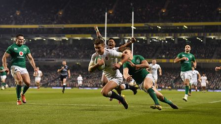 England's Henry Slade scores his team's third try during the Guinness Six Nations match at the Aviva