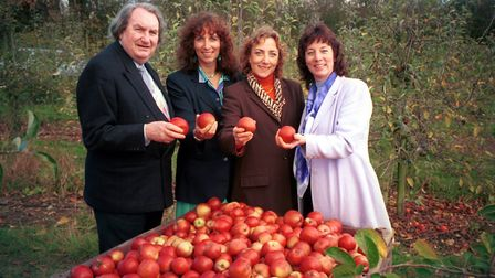 Sir John Harvey-Jones with Susanna, Tamara and Carmella in the orchard in 1999 Pictures: Stoke by N