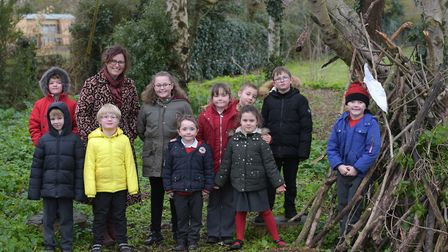 Snape Primary School have won an RHS award for gardening. Sarah Gallagher with some of the children